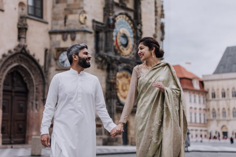 Beautiful couple with traditional wedding cloths at Old Town Square